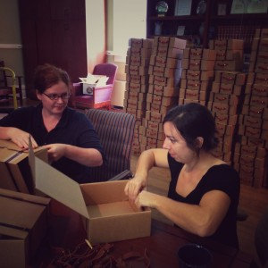Margaret Gaffney and Abby Huggins prepare suitcase-inspired lunch boxes for the SFA symposium