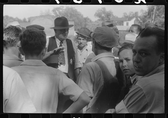 Chief of police talking to CIO pickets outside a mill in Greensboro, Greene County, Georgia