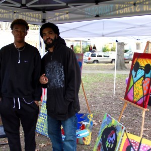 Local visual artist Steve Hendrix (right) showing his work at 3rd Eye Music Festival.